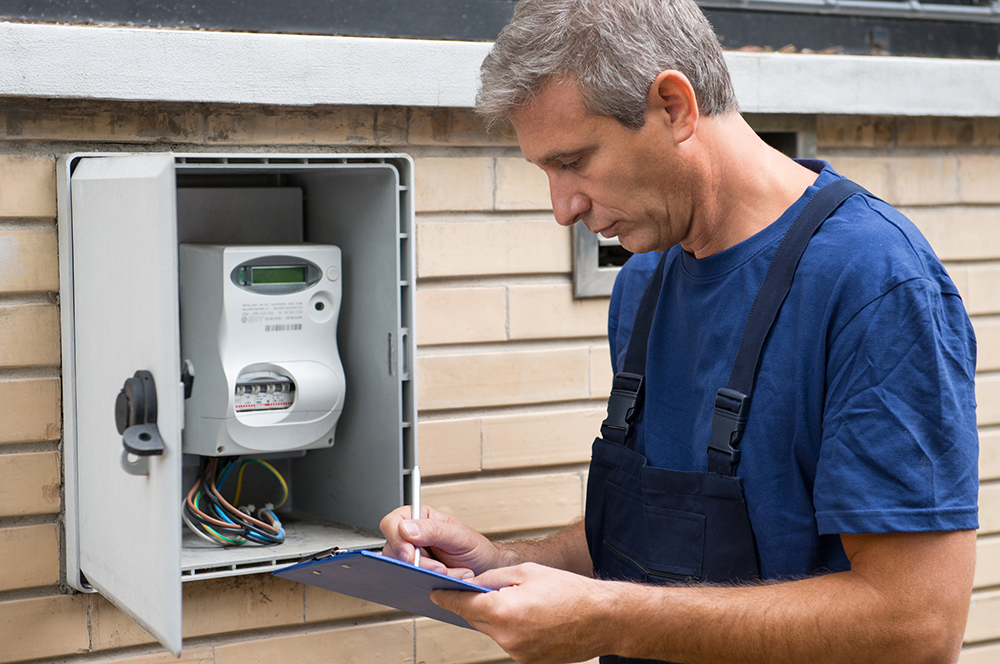 Air conditioner repair man checking levels