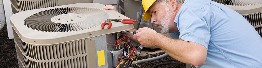 Professional repairman checking air conditioning unit