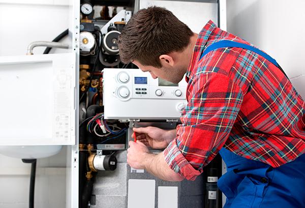 Technician fixing water heater