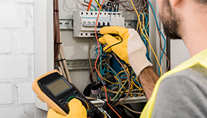 Man fixing electrical outlet