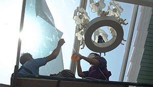 Two men installing window film