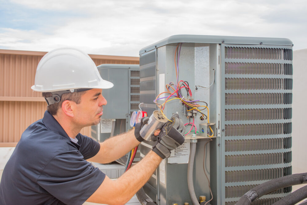 HVAC technician completing a repair