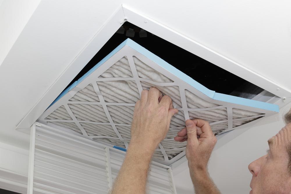 Man removing an air filter