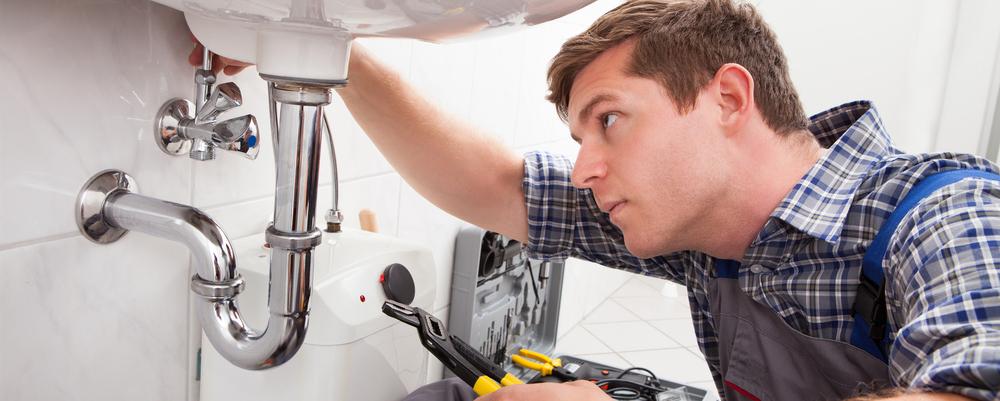 Repairman under sink